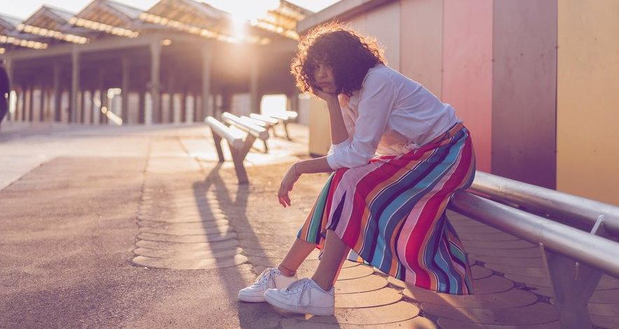 bored-woman-sitting-in-street
